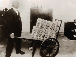 wheelbarrow-of-money-400